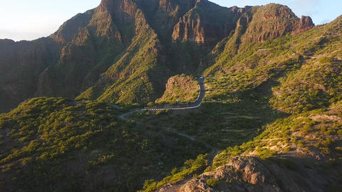 View from the height of the rocks and winding road in the Masca at sunset Footage