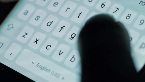 Female hands typing or texting with a smartphone. White, back-lit background Footage