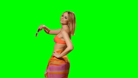 A woman in a swimsuit on a green background (alpha channel) Footage