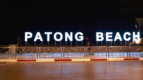 man skateboarding by patong beach sign Footage