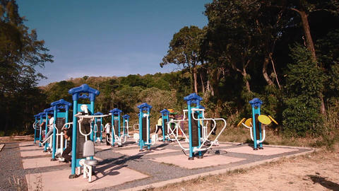 people exercising at outdoor gym in thailand Live Action