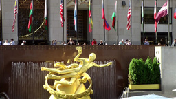 New York City 698 fountains, flags & the golden angel on Rockefeller Plaza Footage