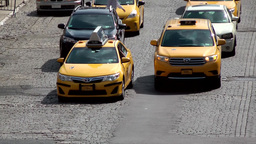 New York City 676 downtown cobblestones street with yellow taxis Footage