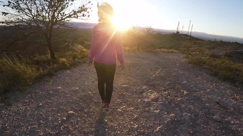 Young Walking Into The Sunset In The Mountains stock footage