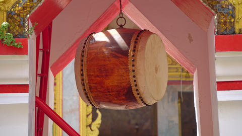 Buddhist drum for rituals in the Buddha temple, a religious place in Asia Live Action
