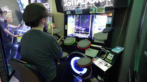 Boy playing drums game in entertainment center Footage