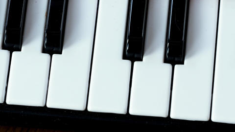 Black and white piano keyboard in detail. Piano keyboard. Home musical Footage