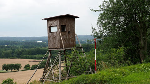 Wooden lookout tower for hunting. Field and forest in Czech republic. Rural Footage