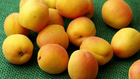 Ripe apricots. Green background. Food for a vegan and a vegetarian. Diet, detox, Footage