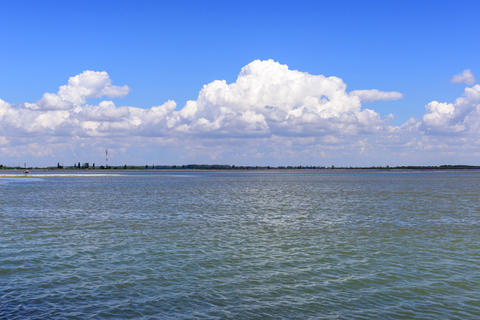 view of the water and the sky with white fluffy clouds, Ukraine Photo
