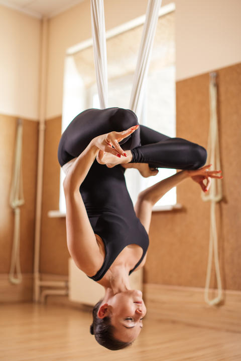 unnata aerial yoga including lotus pose Photo