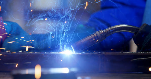 Female welder using blowing torch on a rod 4k Live Action