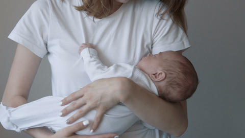 Young mother holding her newborn baby Footage