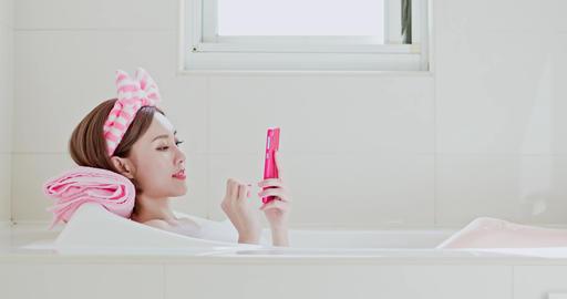woman use phone in bathtub Footage