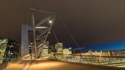 Oslo city skyline timelapse at Akrobaten pedestrian bridge and Bercode Project, Footage