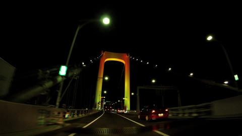 Japanese city night view. Capital Highway and Rainbow Bridge Footage