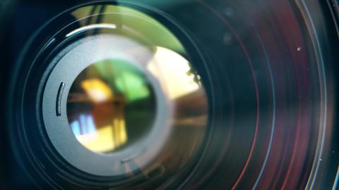 Focusing lens of digital camera. The Lens Of The Camera. Close-Up. Camera Focus Live Action
