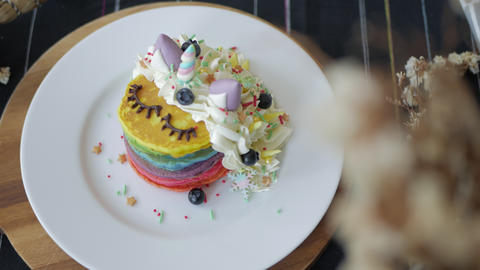 Rainbow Pancake with buttercream berry and decorate sugar. kids meal GIF