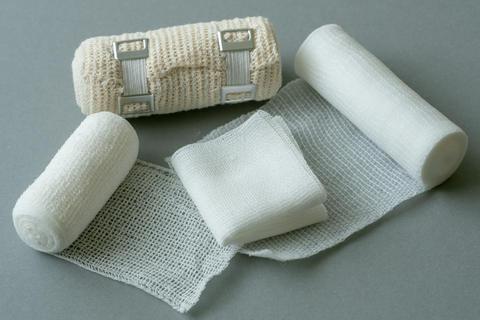 Medical bandages on gray background. Medical equipment Fotografía
