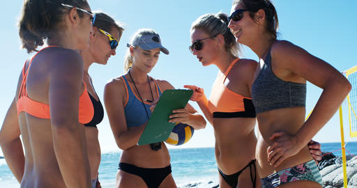 Female volleyball coach interacting with female players 4k Live Action