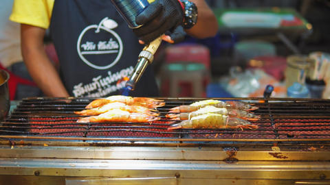 street food asia, traditional Asian dishes. seafood shrimp on the grill, the Live Action
