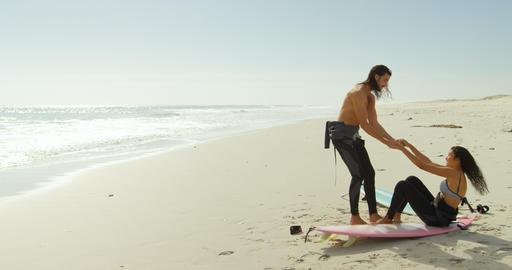 Surfer couple having fun on the beach 4K 4k Footage