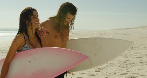 Couple with surfboard walking on the beach 4K 4k Live Action