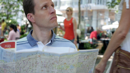 Man Looks at New York Map Footage