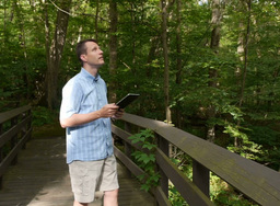 Man with iPad in Woods Footage