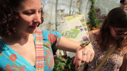 Women Look At Butterfly On Hand stock footage