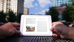 eBook Reader in the City 3627 Footage