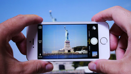Tourist Takes Picture of Statue of Liberty 3651 Footage