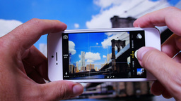 Tourist Takes Picture of Brooklyn Bridge 3653 Footage