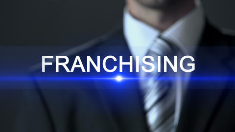 Franchising, businessman in official suit touching screen, commercial branch ビデオ