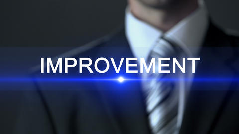 Improvement, male in business suit touching screen, professionalism, development ビデオ