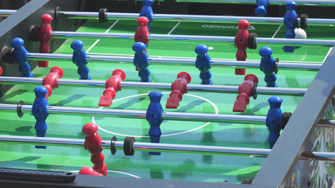 People play kicker table football soccer Live Action