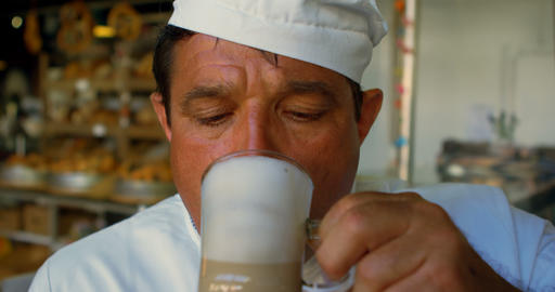 Chef drinking chocolate milkshake in commercial kitchen 4k Live Action
