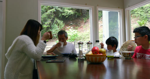 Family members having breakfast on dining table 4k Live Action