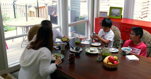 Family members having breakfast on dining table 4k Footage