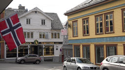 Europe Norway Karmsund Haugesund Norwegian flag & Pharmacy in old building ビデオ