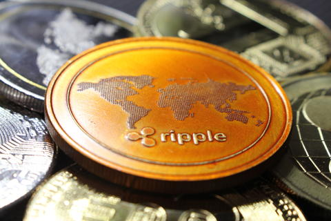 Ripple - a new cryptocurrency revolutionizing digital payment - coin with other Fotografía