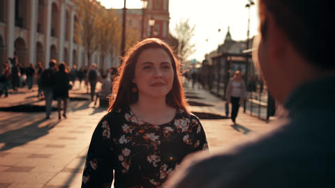 Charming brunette woman with freckles running to hug her boyfriend at urban Footage