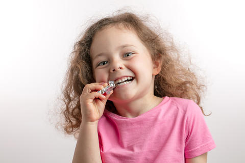 little smiling girl likes chocolate Photo