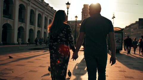 Outdoor lifestyle portrait of young couple in love walk in city on the street Footage
