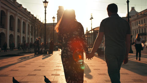 Outdoor lifestyle portrait of young couple in love walk... Stock Video Footage