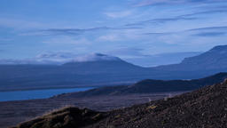 Time lapse of Mountain Peaks and Clouds time lapse in Iceland with barren yellow Footage