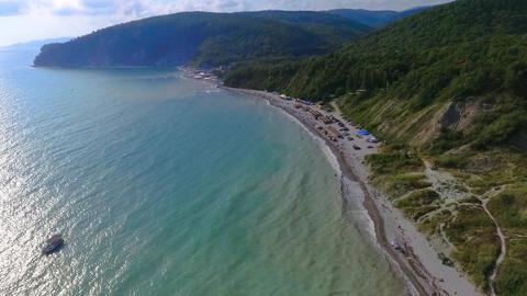 People swim in the sea. Blue Bay of the Black sea Beautiful beach in the black Footage