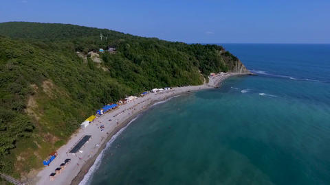People swim in the sea. Blue Bay of the Black sea Beautiful beach in the black Live Action