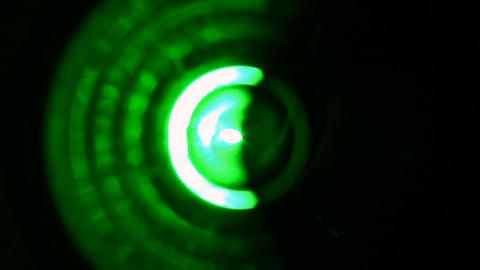 Soft focused spinning green LED lights Footage