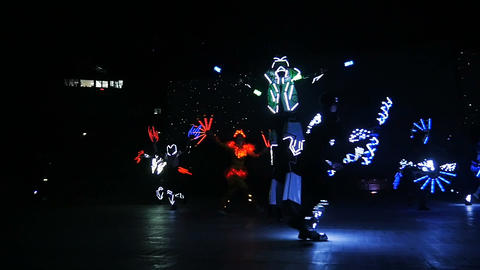 amazing neon dance show performed by skilled dancers in darkness Footage